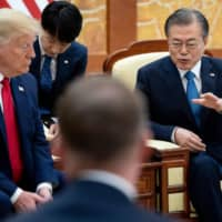 U.S. President Donald Trump attends a bilateral meeting with South Korean leader Moon Jae-in at the presidential Blue House in Seoul on Sunday. | AFP-JIJI