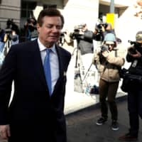 Former Trump campaign chairman Paul Manafort departs from U.S. District Court in Washington in 2018. | REUTERS