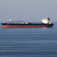 An oil tanker passes through the Strait of Hormuz. The U.S. Senate will vote Friday on an amendment that would ban Republican President Donald Trump from attacking Iran without first obtaining congressional approval. | REUTERS