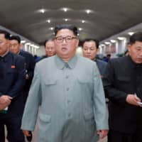 In this undated picture released Saturday, North Korean leader Kim Jong Un is seen visiting the  February 8 General Machine Factory. | AFP-JIJI