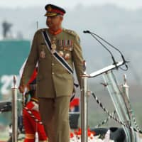 The chief of staff of Pakistan's army, Gen. Qamar Javed Bajwa, arrives for the Pakistan Day military parade in Islamabad on March 23. | REUTERS