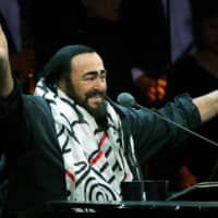 Italian opera star Luciano Pavarotti gestures during part of his round-the-world farewell tour concerts in Shanghai in 2005. | REUTERS