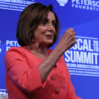 U.S. House Speaker Nancy Pelosi sits for an onstage interview about the U.S. budget at the Peterson Foundation's annual Fiscal Summit in Washington Tuesday. | REUTERS