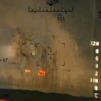 A U.S. military image released by the Pentagon in Washington on Monday that the Pentagon says was taken from a U.S. Navy MH-60R helicopter shows what the Navy says are the remnants of the magnetic attachment device of an unexploded limpet mine on the side of the Japanese owned tanker Kokuka Courageous in the Gulf of Oman on June 13. | U.S. NAVY / HANDOUT / VIA REUTERS