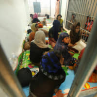 Thailand charges crew of stranded Rohingya boat with aiding illegal immigration