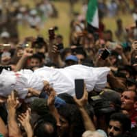 Syrian rebel town buries goalie who became 'singer of the revolution'
