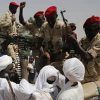 Sudanese soldiers from the Rapid Support Forces unit led by Gen. Mohammed Hamdan Dagalo, the deputy head of the military council, are greeted by supporters as they secure the area where Dagalo attends a rally, in Khartoum Tuesday. | AP