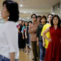 South Koreans attend a senior model class in Seoul on June 13. | REUTERS