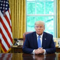 U.S. President Donald Trump speaks during a meeting in the Oval Office of the White House in Washington on Tuesday. | AFP-JIJI