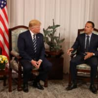 U.S. President Donald Trump listens as Irish Prime Minister (Taoiseach) Leo Varadkar speaks at Shannon Airport in Shannon, Ireland, Wednesday. | REUTERS