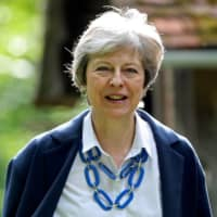 With Prime Minister Theresa May about to hand over the reins of power in Britain, candidates to succeed her now feel free to speak out on issues such as Huawei's role. | REUTERS