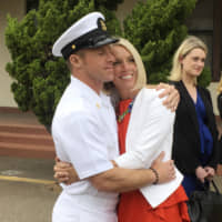 U.S. Navy Special Operations Chief Edward Gallagher hugs his wife, Andrea Gallagher, after leaving a military courtroom on Naval Base San Diego on Thursday. | AP