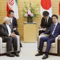Prime Minister Shinzo Abe and Iranian Foreign Minister Mohammad Javad Zarif hold talks at the Prime Minister's Office in Tokyo on May 16. Abe is set to visit Iran next week. | KYODO