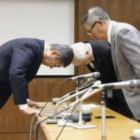 Defense Minister Takeshi Iwaya (left) bows to Akita Gov. Norihisa Satake at the Akita Prefectural Government building on Monday, as he apologizes for errors in the ministry's geographical survey used for plans to deploy the Aegis Ashore missile defense system in the prefecture. | KYODO