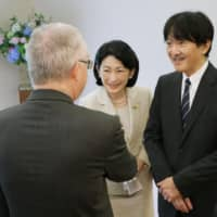 Crown Prince Akishino and Crown Princess Kiko greet an ambassador in Tokyo on Thursday morning before leaving for Europe the same day. | POOL / VIA KYODO