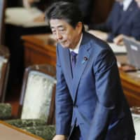 Abe survives censure motion by opposition over controversial pension report