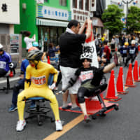 Contestants take part in the office chair race 'Isu-1' Grand Prix held in Hanyu, Saitama Prefecture, on Sunday. | REUTERS