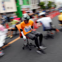 Racers compete during ISU-1 Hanyu Grand Prix, while taking part in the office chair race ISU-1 Grand Prix series, in Hanyu, north of Tokyo. | REUTERS