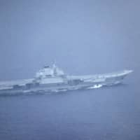 This photo provided by the Defense Ministry shows China's aircraft carrier, the Liaoning, headed to the Pacific on Monday. | KYODO