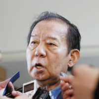 Toshihiro Nikai, the ruling Liberal Democratic Party's secretary-general, briefs reporters at the Prime Minister's Office in Tokyo on June 4. | KYODO
