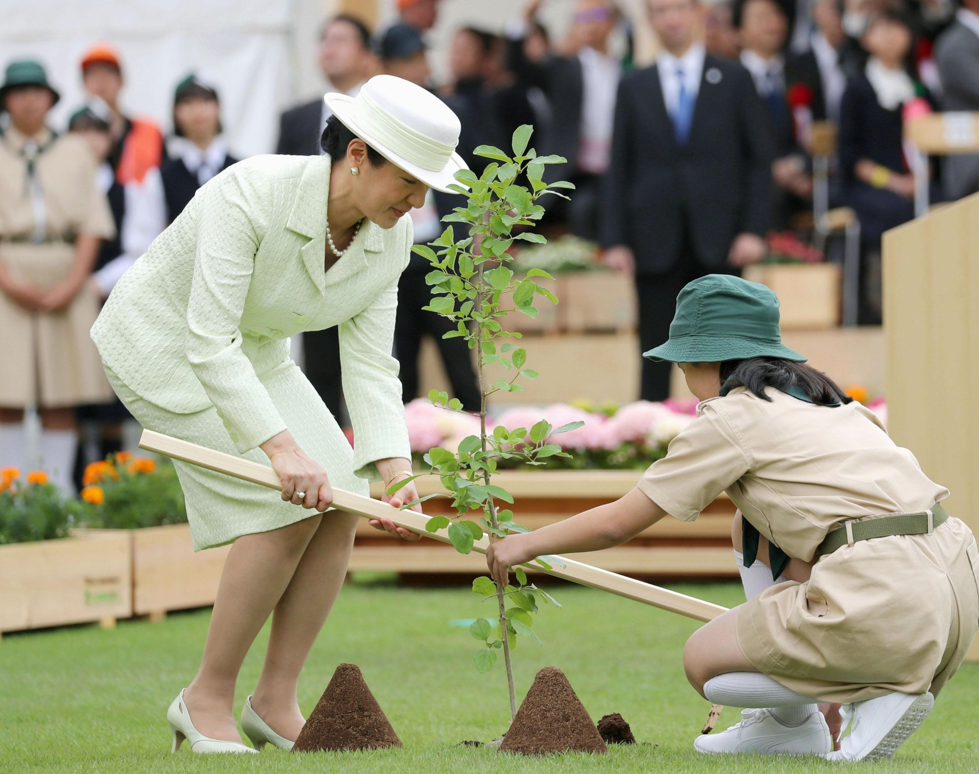 Empress Masako plants a tree during a national tree-planting ceremony in Owariasahi, Aichi Prefecture, on Sunday in her first official duty outside Tokyo since Emperor Naruhito ascended the throne on May 1. | KYODO
