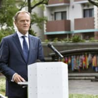 European Council President Donald Tusk visits A-bomb sites in Nagasaki and Hiroshima ahead of G20