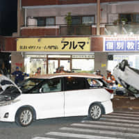 Elderly driver, 81, and wife die after their speeding car slams into vehicle at intersection in Fukuoka