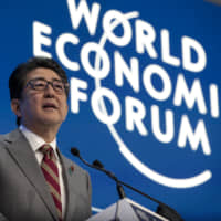 Prime Minister Shinzo Abe delivers a speech during a special address on the second day of the World Economic Forum's annual meeting in Davos, Switzerland, on Jan. 23. | BLOOMBERG