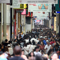 People crowd a shopping area in downtown Osaka on Wednesday as the city prepares to host world leaders for the G20 summit. | AFP-JIJI