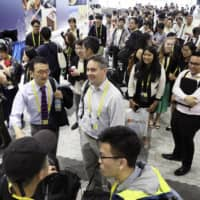 Journalists gather at the Intex Osaka convention center on an artificial island in Osaka Bay on Thursday, the venue for the two-day Group of 20 summit that starts Friday. | KYODO