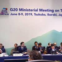 Hiroshige Seko (third from right), minister of economy, trade and industry, delivers his opening address on Saturday at the digital economy portion of a G20 ministerial meeting in Tsukuba, Ibaraki Prefecture. | MASUMI KOIZUMI