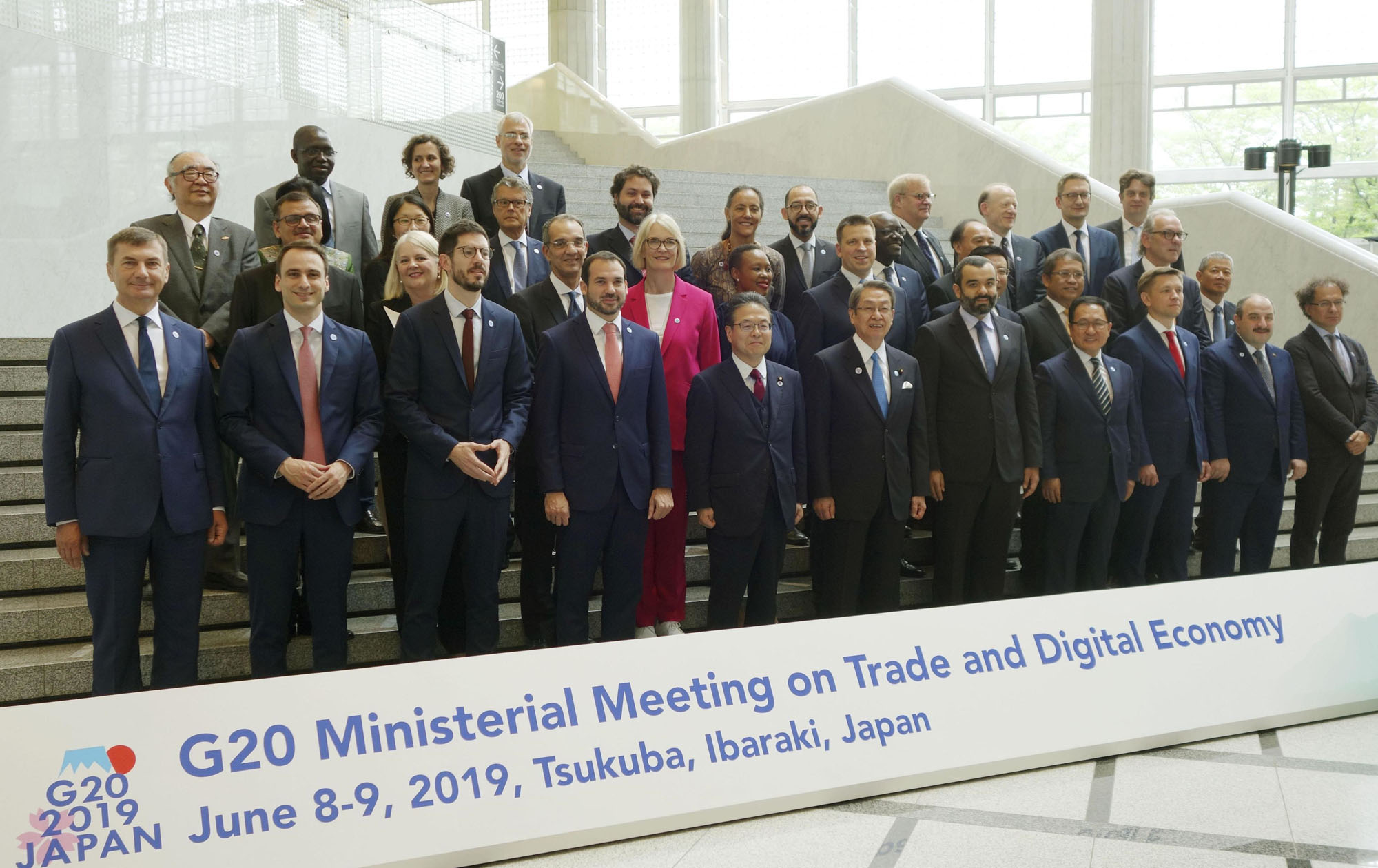 Ministers in charge of trade and digital economy issues pose Saturday during a G20 ministerial meeting in Tsukuba, Ibaraki Prefecture. | KYODO