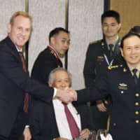 Acting U.S. Secretary of Defense Patrick Shanahan (left) and Chinese Defense Minister Gen. Wei Fenghe shake hands during the Shangri-La Dialogue in Singapore on June 1. | KYODO