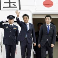 Prime Minister Shinzo Abe boards the government plane at Haneda airport in Tokyo on Wednesday for a two-day trip to Iran. | KYODO