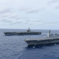 Japan's largest warship joins U.S. carrier for military exercises in disputed South China Sea