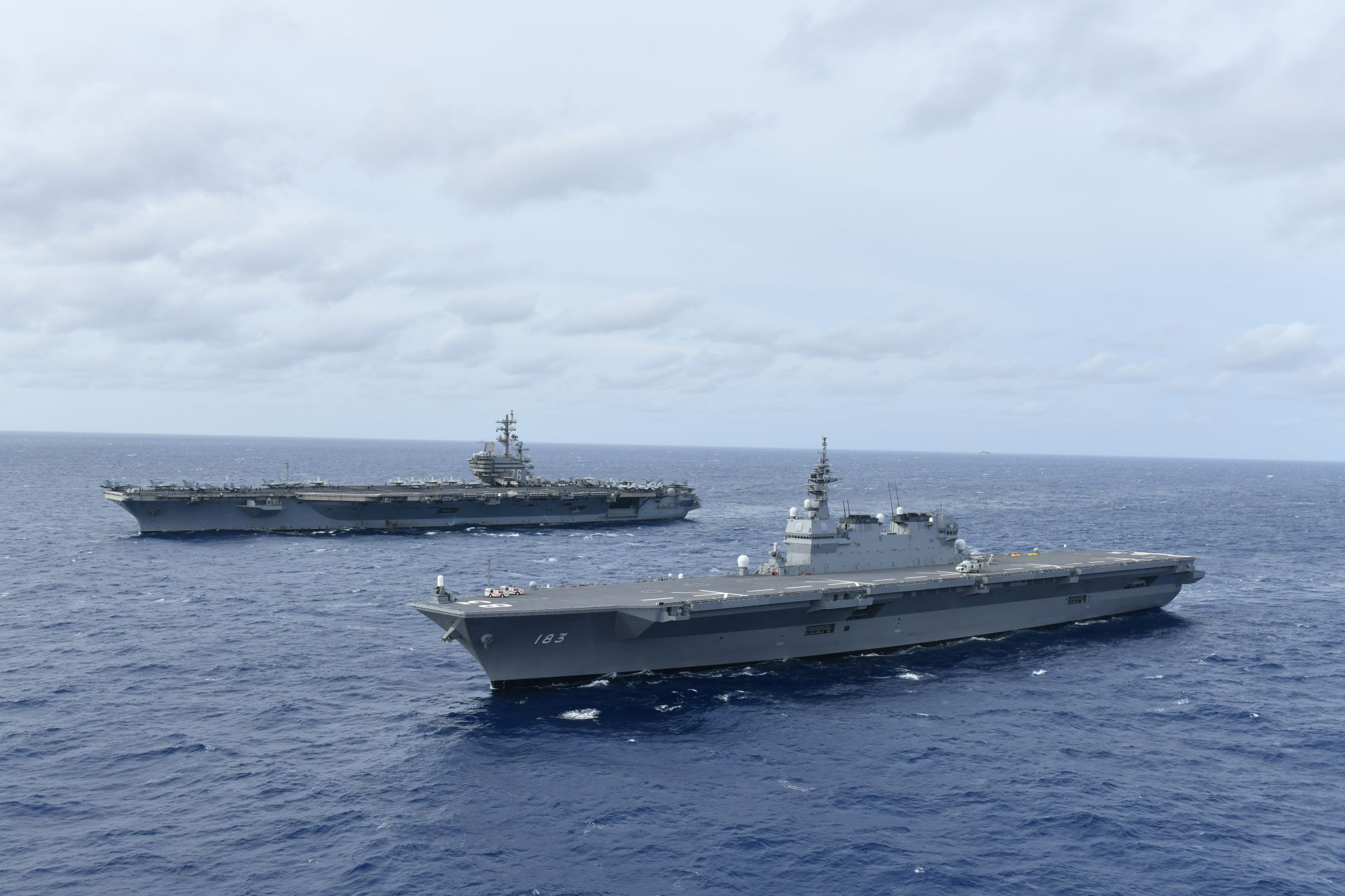 The Maritime Self-Defense Force's Izumo, Japan's largest flat-topped helicopter carrier, joins the United States' sole forward-deployed aircraft carrier, the USS Ronald Reagan, for joint military exercises in the disputed South China Sea this week. | MARITIME SELF-DEFENSE FORCE