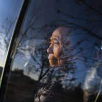 Akiko Ota, one of the Japanese wives who moved to North Korea, looks out a car window in Hamhung in November 2018. | COURTESY OF NORIKO HAYASHI / VIA KYODO