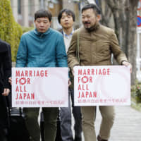 Plaintiffs head to the Osaka District Court on Feb. 14 to file a lawsuit against the government over marriage equality, arguing that its refusal to allow same-sex couples to marry is unconstitutional and discriminatory. | KYODO