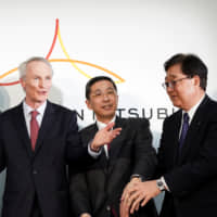 Renault CEO Thierry Bollore (left), Chairman Jean-Dominique Senard, and Nissan Motor President and CEO Hiroto Saikawa  attend a news conference in Yokohama in March. | BLOOMBERG