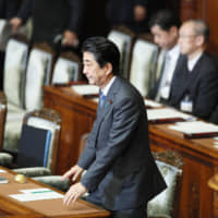 Prime Minister Shinzo Abe survives a no-confidence motion submitted against the Cabinet by opposition parties in the House of Representatives on Tuesday. | KYODO