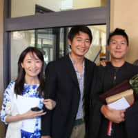 Agnes Chan poses with her three sons at her second son Shohei's graduation ceremony at Stanford University in 2015. | COURTESY OF T&A / VIA KYODO