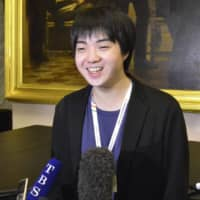Mao Fujita speaks to reporters Thursday in Moscow after tying for second place in the piano category of the 16th International Tchaikovsky Competition. | KYODO