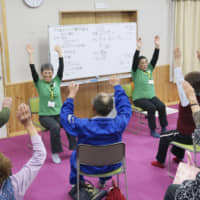 Elderly people participate in an exercise class in Miyota, Nagano Prefecture, in May. | KYODO