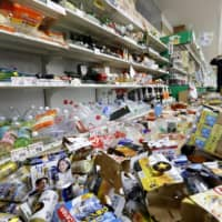 Cans and bottles are scattered on the floor of a supermarket  in Tsuruoka, Yamagata Prefecture, Wednesday following a major quake that hit Japan's northeastern region late Tuesday. | KYODO