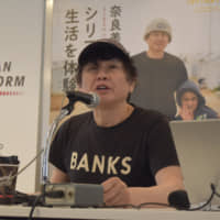 Contemporary artist Yoshitomo Nara speaks at an event Saturday at the United Nations University in Tokyo. | KYODO