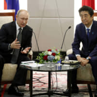 Russian President Vladimir Putin speaks with Prime Minister Shinzo Abe during a bilateral meeting on the sidelines of the G20 summit in Osaka on Saturday.   BLOOMBERG