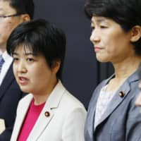 Lawmaker Kanako Otsuji (left) of the Constitutional Democratic Party briefs reporters Monday in Tokyo on a bill that would legalize same-sex marriage. | KYODO