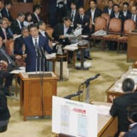 Prime Minister Shinzo Abe speaks Monday during a meeting of the Audit Committee of the House of Councilors. | KYODO