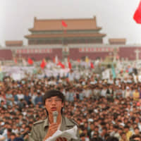 Student leader Wang Dan speaks in Tiananmen Square in Beijing on May 27, 1989, calling for a citywide march. | AP