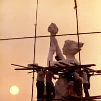 Protesters occupying Beijing's Tiananmen Square work on the statue of the 'Goddess of Democracy' on May 30, 1989. The makeshift statue, modeled after the Statue of Liberty, was destroyed, and hundreds of people killed, when Chinese soldiers overran the square in the early morning hours of June 4, 1989. | AP